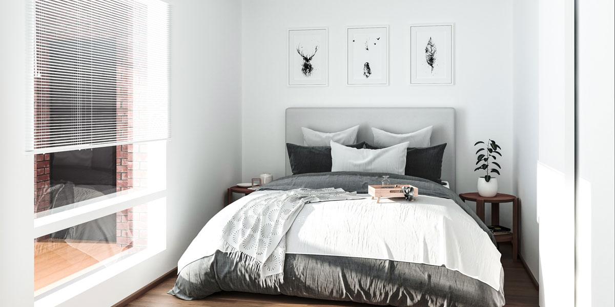 Rakennusliike Rakennus-hankan tuottaman talon modernisti sisustettu harmaa-valkosävyinen makuuhuone